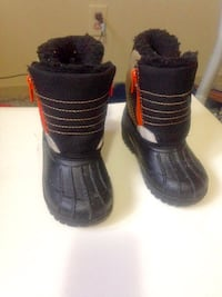 Pair of black leather boots size 6 kids  Winnipeg, R2K 4A1