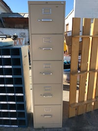 Tan file cabinet  5 drawers   Has a couple dents on side  Turlock, 95380