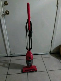 red and black Dirt Devil upright vacuum cleaner Houston, 77091