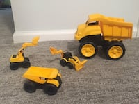 Four yellow and black toy construction vehicles