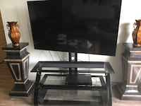 black flat screen TV and black TV stand Brentwood, 37027