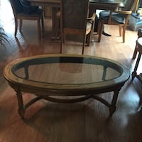 round brown wooden framed glass top coffee table San Antonio, 78259