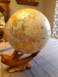 Globe with wooden dolphin base