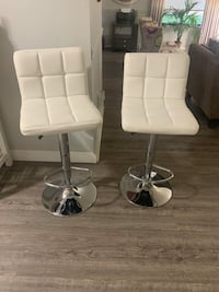 Two adjustable hwight barstools white