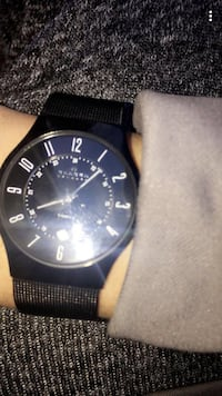 round black chronograph watch with black leather strap Calgary, T2E 3A4