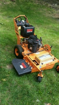 orange and black zero turn mower 76 km
