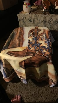 pair of brown -and-blue cowboy boots printed blanket