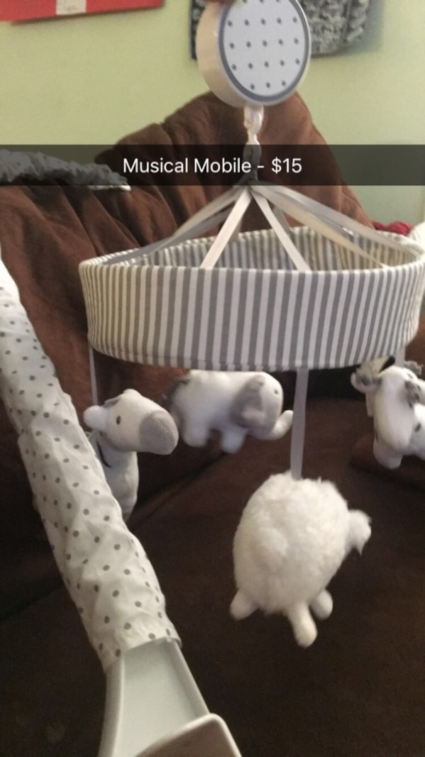 White and gray polka dot crib mobile