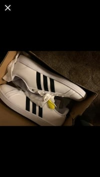 pair of white Adidas low top sneakers Lancaster, 93536