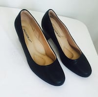 pair of black leather heeled shoes 793 km