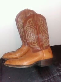 pair of brown leather cowboy boots Houston, 77021