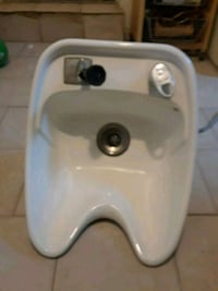 Porcelain sink with faucet
