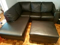 Brown faux leather fold-out couch with ottoman Toronto, M6P 2Z7