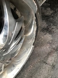 24in rims one rim is cracked 3good rims&tires I payed 1800 rim&tires