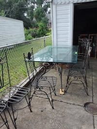 Vintage glass and iron outdoor table set