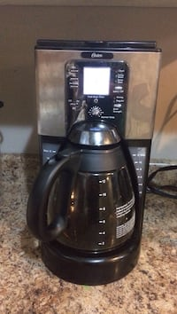 black and gray Oster coffeemaker