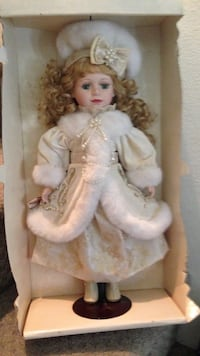 Female doll wearing white floral dress, coat and hat in box Anaheim, 92808