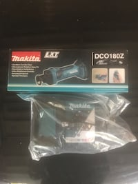 Makita cut out tool and charger Both brand new Oro-Medonte, L3V 0E3