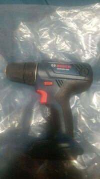 black and red Bosch cordless hand drill
