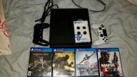 black Sony PS4 console with controller and games Coquitlam