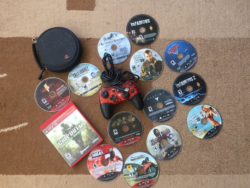 14 PS3 games and controller 9af55078-fdd8-41bf-a3e0-159fe63df65f