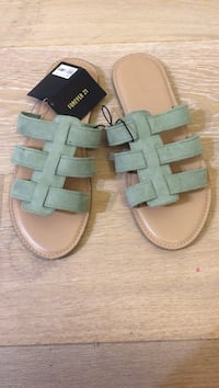 Green and tan suede sandals
