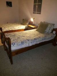brown wooden bed frame with white mattress Ocean City, 21842