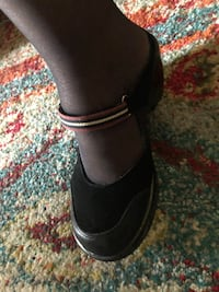 Pair of black leather chunky Clogs