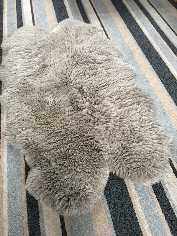 Genuine sheep skin rug brought from dunelm for £116 pounds from a smoke free home collection only please