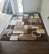 Brown and cream color , 5'by8' ,new area rug. $50 Saint Paul, 55116