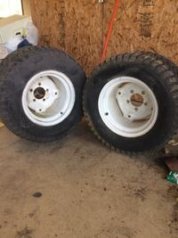 two white bullet hole car wheels with tires Greenwood, 19950