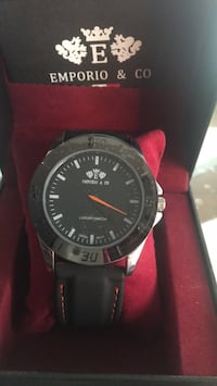 round black analog watch with black leather strap Laval, H7X 4B4