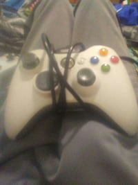 white and black Xbox 360 game controller Alfred, 04002