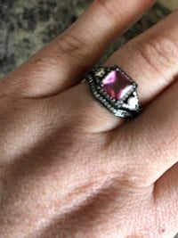 Silver-colored ring with pink gemstone