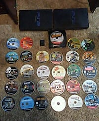 black Sony PS2 console with game discs Red Oak, 75154