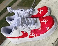 pair of white-and-red Nike sneakers Tecumseh