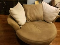 brown suede sofa chair with throw pillow Laval, H7L