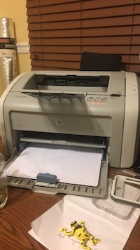 white and gray HP desktop printer