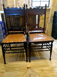 4 brown wooden armless chairs