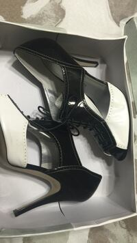 Pair of black and white leather lace up heeled boots in box San Leandro, 94578