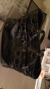 Black leather coach monogram tote bag in excellent condition Calgary, T2R 0S5