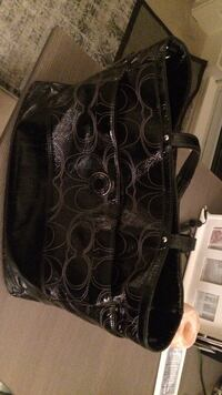 Black leather coach monogram tote bag in excellent condition