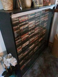 brown wooden framed glass display cabinet Albuquerque, 87105