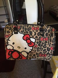 Brown, white, and red Hello Kitty leather tote bag Victoria, V9A 2B4