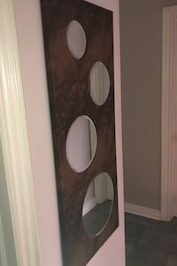 Circle mirror 20x49 faux ostrich leather finish.  Purchased for 99.99 Mississauga, L5A 2S1