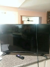black flat screen TV with remote Santa Teresa, 88008
