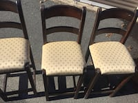 Two brown wooden framed white padded chairs Marshall, 20117