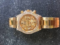 round gold chronograph watch with link bracelet Vancouver, V5W 1A5
