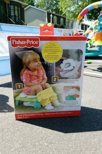 Never used!!! Brand new. Fisher-price 2 in 1 portable potty Laval