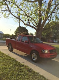red single cab pickup truck Fort Meade, 33841